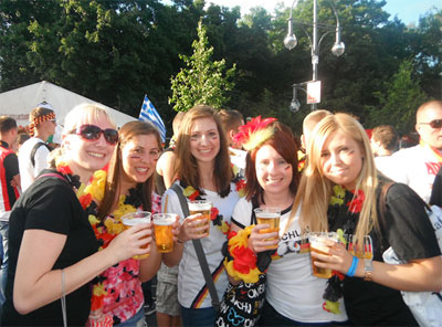 Bridget with her friends holding beers at the Berlin Fan Mile watching the quarter final of the European Championship