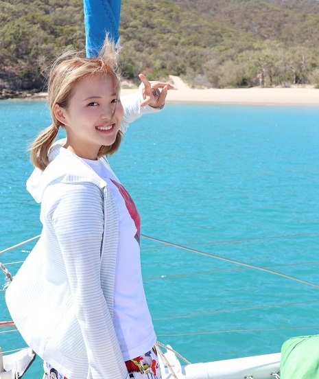Kaede Suzuki standing on a boat on the water off Great Keppel Island