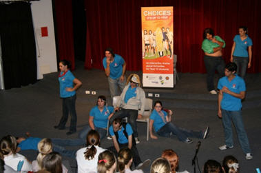 Actors mid-performance of Choice Applied Theatre Program. School student audience watching.