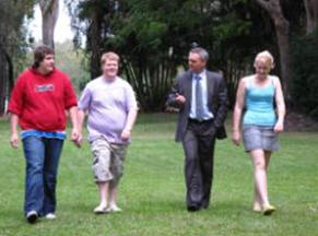 4 people walking together outside