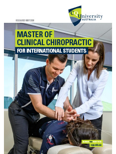 Clinical Chiropractic student being guided by a lecturer on how to align a patients spine