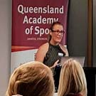 Dr Mel Hayman (second from left) with other Female Athlete Breakfast Series participants, L-R Dr Sharon Stay (Sports and Exercise Physician), Rebecca Ryan (QAS Physical Performance Coach) and Hockeyroo Jodie Kenny. BELOW: Dr Hayman delivers her presentation.