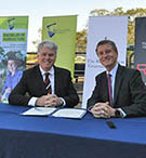 TOP: The Rockhampton Grammar School Headmaster Phillip Moulds (left) and CQUniversity Vice-Chancellor Professor Nick Klomp at the MOU signing ceremony. BELOW: Getting a feel for the cattle yards at the Central Queensland Innovation and Research Precinct (CQIRP).