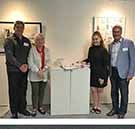 TOP: L-R CQUniversity Deputy Vice-Chancellor for Engagement, Campuses and Mackay-Whitsunday Region Professor Pierre Viljoen, Art Collection Manager Susan Smith, Bachelor of Education (Secondary) student Brianna Brett and Mackay Regional Council Mayor Councillor Greg Williamson at the CQU Creates 2019 touring exhibition on the Mackay City campus. BOTTOM: Brianna's winning artwork, Thymoma - an embroidered fabric sculpture in the form of a diary released from a ribcage.