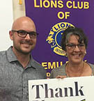 Bachelor of Education (Secondary) student Temil Ludwig accepts his scholarship from Emu Park Lion's President Val Wex.