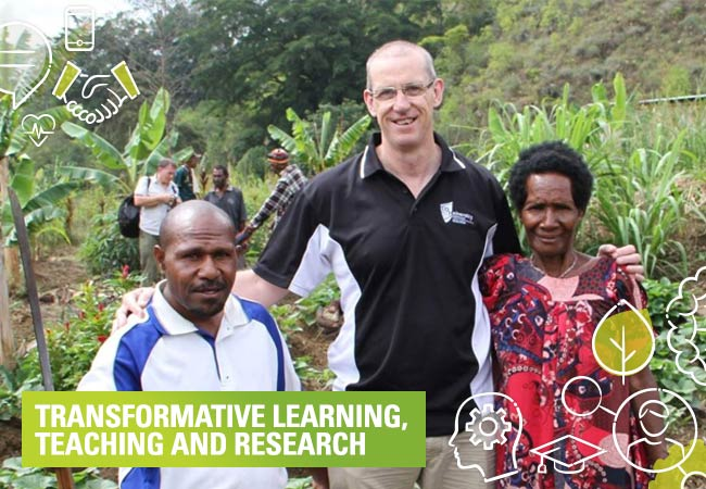 CQUni staff member Philip Brown with community members the CQU Social Innovation are helping