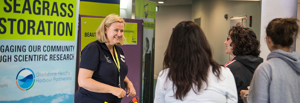 CQUniversity lecturer talking to three interested female prospect students.