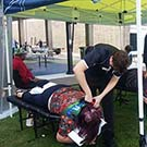 Fifth-year Chiropractic students Lauren Hunter and Lucas Neilsen, travelled from Mackay to Rockhampton to provide treatments to patients during the Homeless Connect Expo in Rockhampton recently.