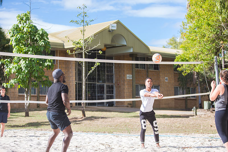 Residents playing beach volleyball at Capricornia College