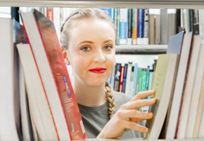 Student browsing library shelves